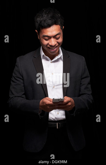 Businessman using smartphone - Stock Image