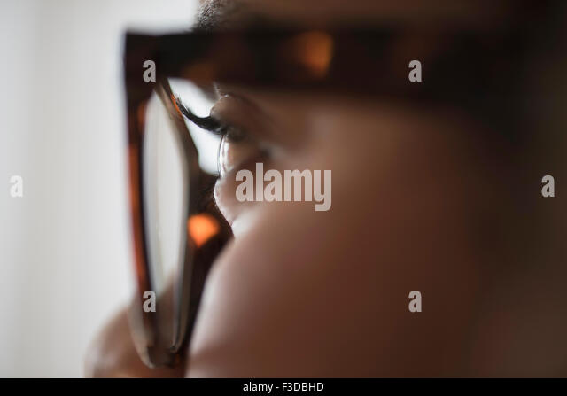 Close up of young woman in nerdy glasses - Stock Image