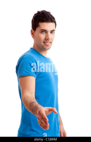 Casual young man giving a handshake, isolated on white - Stock Image