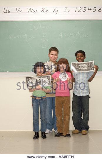 Children holding fake money - Stock Image