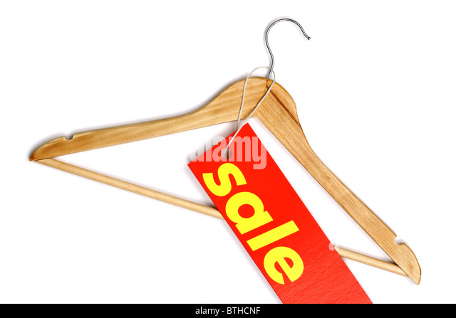 Wooden coat hanger with sale label - Stock Image