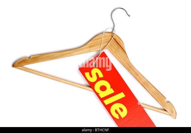 Wooden coat hanger with sale label - Stock Image