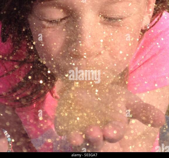 Blowing glitter - Stock Image