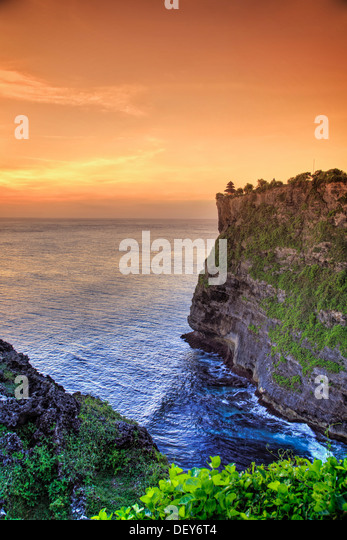 Bali, Bukit Peninsula, Uluwatu, Pura Luhur Uluwatu Temple at sunset, one of the most important directional temples - Stock Image