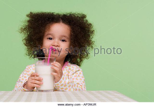 Girl drinking milk - Stock Image