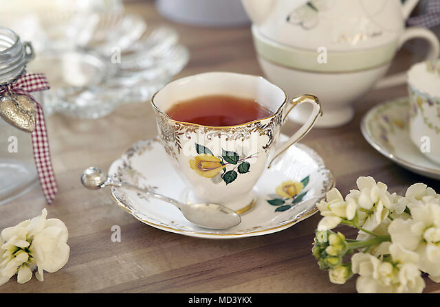 Quaint teacup and saucer on table - Stock Image