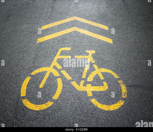 Bycicle sign painted on the road. - Stock Image