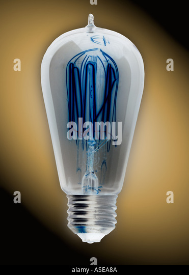 old fashioned Edison style light bulb. The image has been inverted. - Stock Image