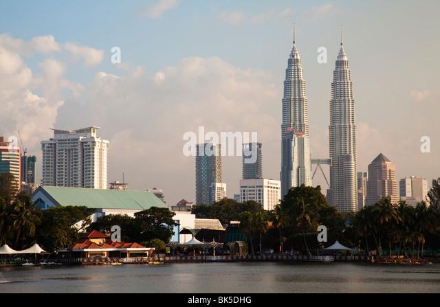 Malaysia Kuala Lumpur skyline Twin Towers lake - Stock Image