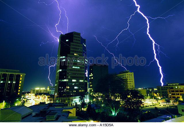 Lightning over city at night downtown Tucson   Arizona Tucson Skyline City - Stock Image
