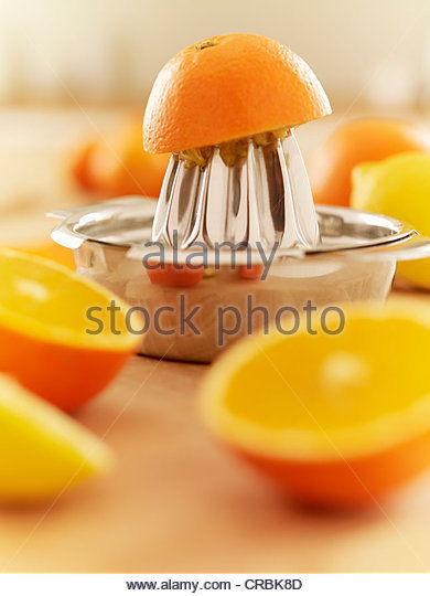 Oranges and juicer - Stock Image
