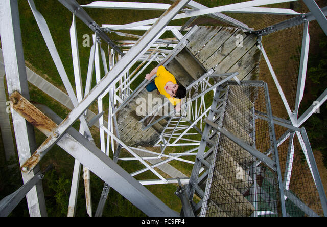 A vertigo-inducing array of criss-crossing metal girders holds together a historic fire lookout tower in the Finger - Stock Image