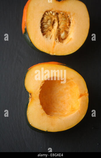 Acorn squash on table - Stock Image