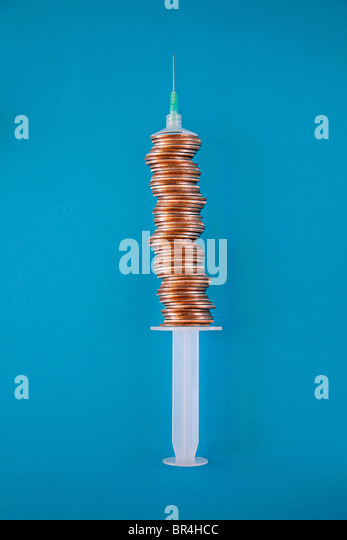 stacked coins make medical syringe barrel - Stock-Bilder