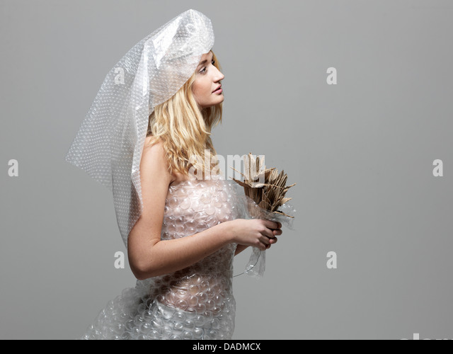 Woman wearing bubble wrap dressed up as bride - Stock Image