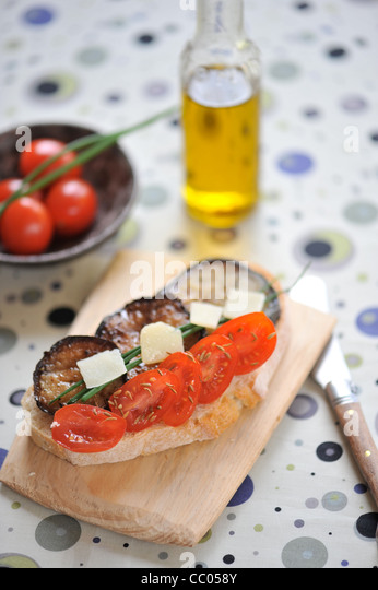 Eggplant, Tomato and Parmiggiano Toasts - Stock Image