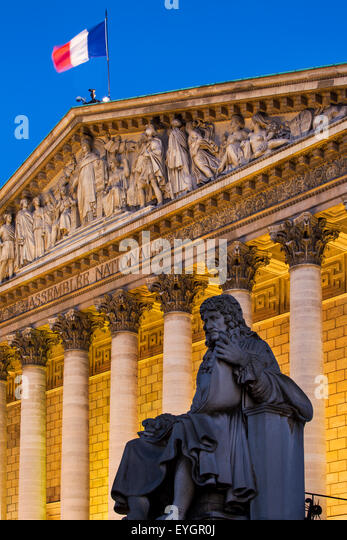 Evening below Jean-Baptiste Colbert statue and the Asselmblee Nationale, Paris, France - Stock Image
