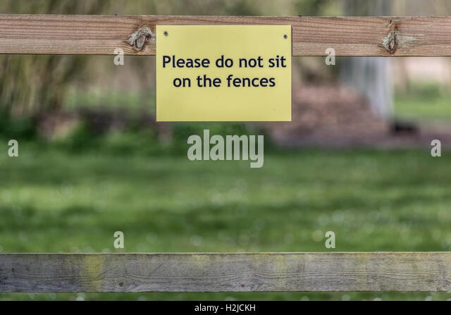Sitting on the fence - Stock Image