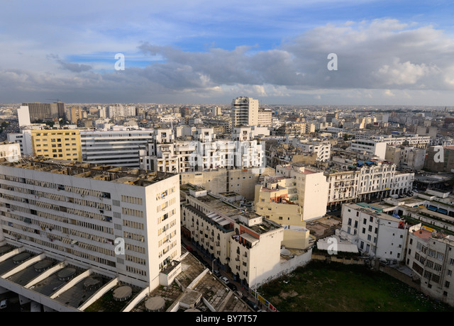 Evening view looking across the white Casablanca cityscape Morocco - Stock Image