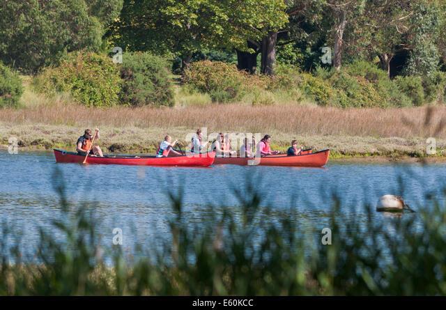 Family canoeing canoe trip Beaulieu River - Stock Image