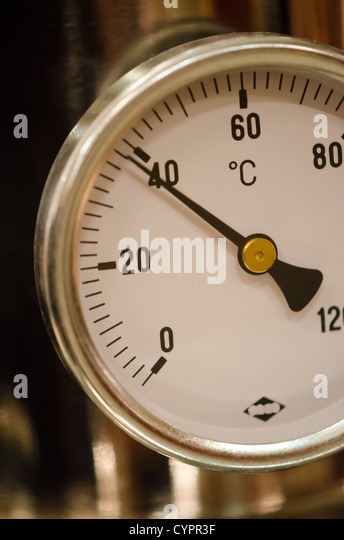 close-up of a white thermometer showing 39 degrees centigrade - Stock Image