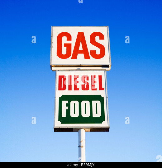 Sign against blue sky that reads gas diesel and food - Stock-Bilder