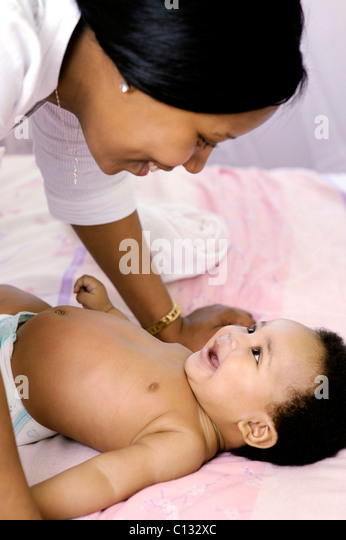 Mother interacting with her baby, Cape Town, South Africa. - Stock Image