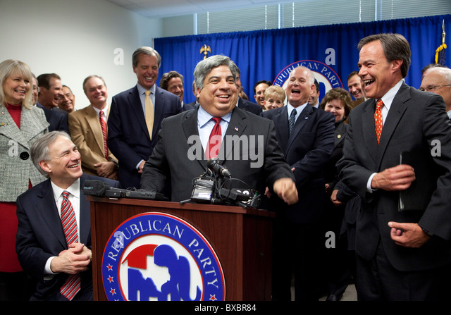 Texas Republicans are all smiles at the defection of state Rep. Aaron Pena (center) from the Democratic to the Republican - Stock Image