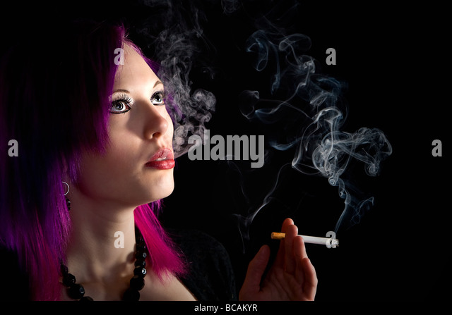Alternative Teenager Smoking a Cigarette - Stock Image