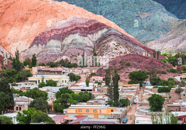 Purmamarca and the HiRMRM of Seven CoRMours (Cerro de RMos Siete CoRMores), Quebrada de Purmamarca, Jujuy Province, - Stock Image