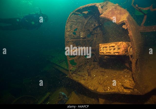 Diver explores fuselage of Zero fighter plane inside the main hold of the Fujikawa Maru Truk lagoon Chuuk - Stock Image