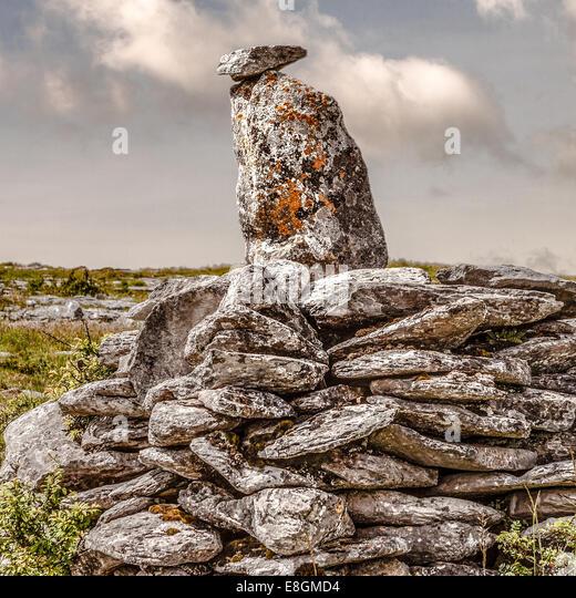 UK, Northern Ireland, Ulster, County Down, Newry, Burren, Two stones balanced on pile of rocks - Stock Image