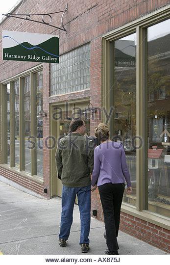 West Virginia Lewisburg couple window shopping walking - Stock Image