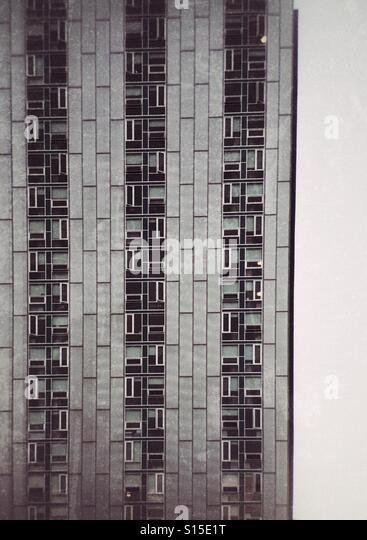 The pattern of an apartment building's windows. - Stock Image