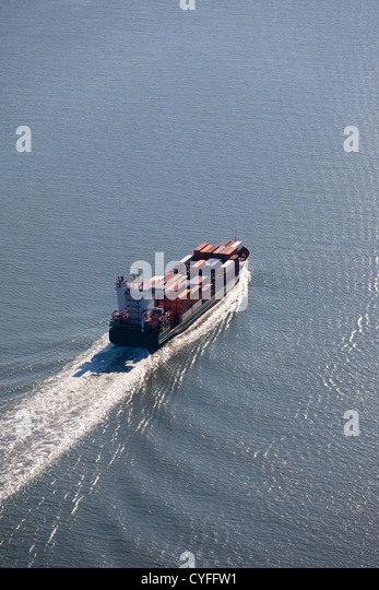 The Netherlands, Nieuw Namen. Container ship in Westerschelde river. Aerial. - Stock Image