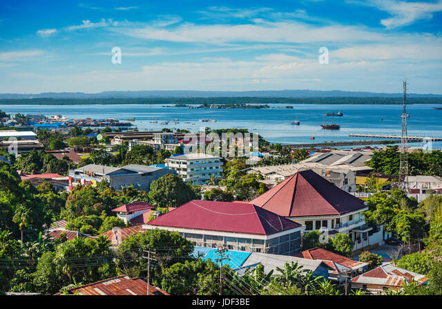 View of city with harbor, Sorong, West Papua, Western New Guinea, Indonesia - Stock Image