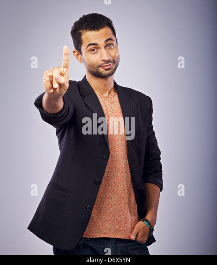 Portrait of a guy gesturing with his hand - Stock Image