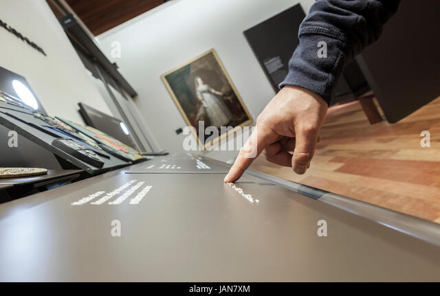 Madrid, Spain - February 24, 2017: Blind reading text caption in braille language at at National Archeological Museum - Stock Image