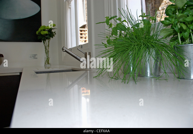 Corian Worktop Stock Photos amp Corian Worktop Stock Images  : close up of herbs in stainless steel pots on white corian worktop cefxaa from www.alamy.com size 640 x 445 jpeg 66kB