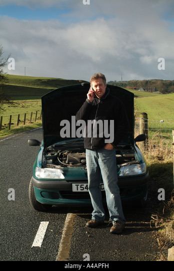 Car breakdown by the side of a remote country road, Scotland. - Stock Image