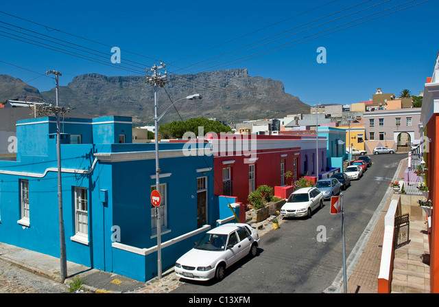 Street in Bo Kaap and Table Mountain, Cape Town, South Africa - Stock Image