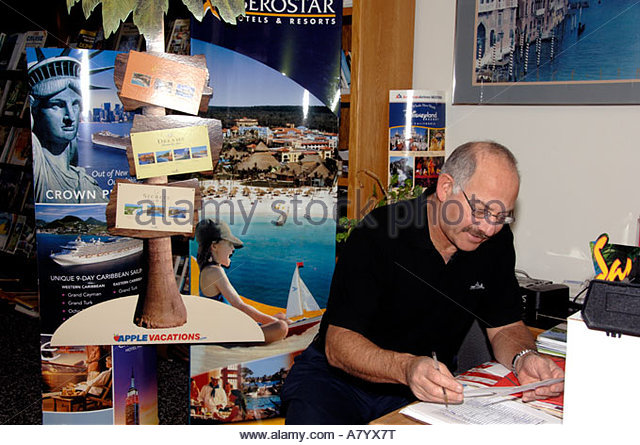 United States, Colorado, Colorado Springs. Travel agency. Male agent. (PR) - Stock-Bilder