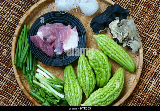 Vietnamese food, soup of bitter melon stuffed with ground meat, a nutrition, popular dish in Vietnam, bitter gourd - Stock Image