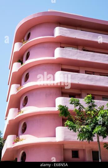 Hawaii Hawaiian Honolulu Waikiki Beach Kuhio Avenue Waikiki Cove residential condominium building pink - Stock Image
