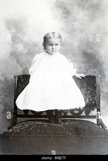 A toddler poses in New Bedford, Massachusetts, for a picture around 1900. - Stock Image