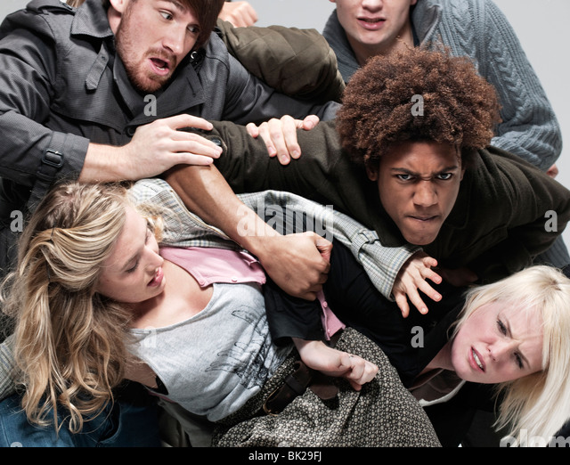 Group of adults fighting for space - Stock Image