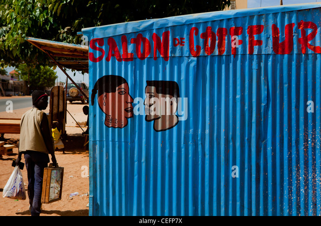 Barber's sign Saly, Senegal - Stock Image
