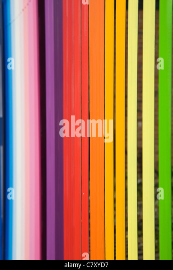 Multi coloured metal fence - Stock Image