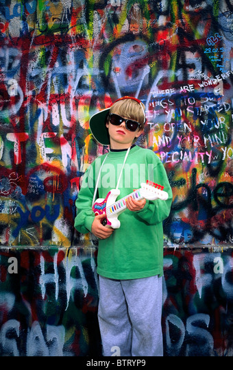 U2 Wall, Dublin, Co Dublin, Ireland, Boy Holding A Toy Guitar - Stock Image