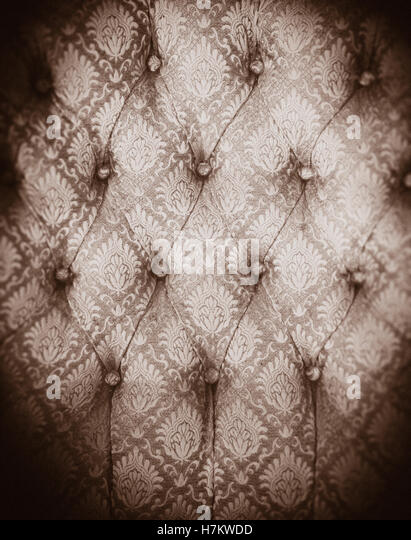 Vintage chair fabric in close up. Background pattern of textile. Old furniture with pattern. - Stock-Bilder